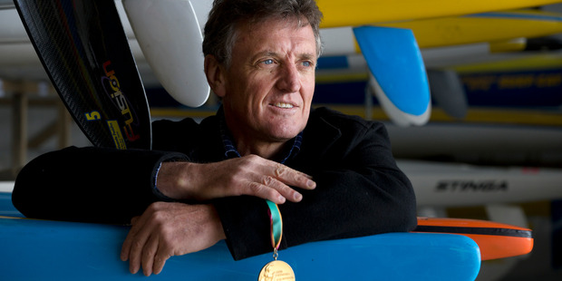 """We firmly believed we could win."" Grant Bramwell, pictured at the Waikanae Surf Club in Gisborne, with the gold medal he won in the K-4 1000m at the 1984 Los Angeles Olympics. Photo / Alan Gibson"