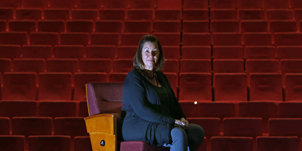 Loading Baycourt Manager, Megan Peacock Coyle, with a new chair that will provide more leg room for theatre goers. Photo/ John Borren