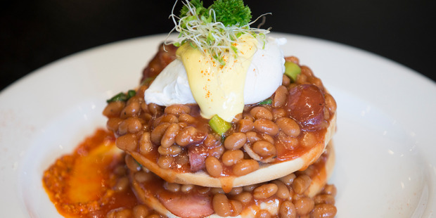 The beans on bagels with bacon, chorizo and an egg at Paper Moon cafe. Photo / Nick Reed