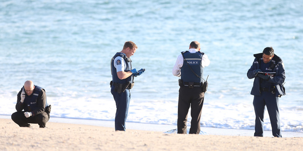Loading Police say they can't rule out foul play following the discovery of a body in the surf at Mount Maunganui this morning. Bay of Plenty Times Photograph by John Borren