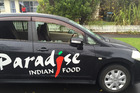 A Paradise takeaways car that has also had its front and side windows smashed in Mt Albert. Photo / Michael Craig