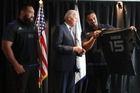 Charlie Faumuina and Jerome Kaino present an All Blacks jersey to US Vice President Joe Biden. Photo / Pool