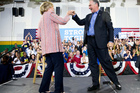Democratic presidential candidate Hillary Clinton fist bumps Sen. Tim Kaine. Photo / AP