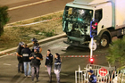 Police investigate the scene after a truck plowed through Bastille Day revellers in the French resort city of Nice. Photo / AP