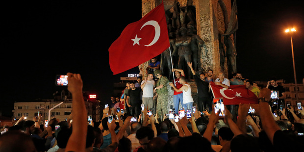 Supporters of Turkey's President Recep Tayyip Erdogan, gather, waving Turkish flags, in Istanbul's Taksim square. Photo / AP