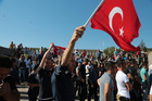 Turks protest against the attempted coup outside Parliament in Ankara, Turkey. Photo / AP