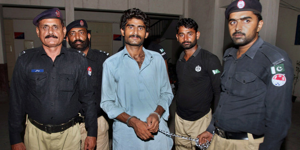 Pakistani police officers present Waseem Azeem, the brother of slain model Qandeel Baloch, before the media following his arrest at a police station in Multan, Pakistan. Photo / AP