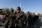 Turkish soldiers march after a mass funeral for the victims of a failed military coup. Photo / AP