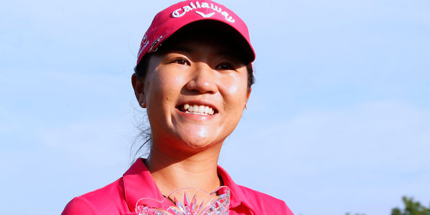 Loading Lydia Ko poses with her trophy after winning the Marathon Classic. Photo / AP