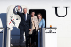 Joe Biden, left, waves as he arrives in Sydney with his granddaughters Naomi, centre, and Finnegan, on Monday. Photo / AP