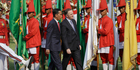 Prime Minister John Key and Indonesian President Joko Widodo inspect an honour guard of traditional Javanese soldiers' prior to their bilateral meeting. Photo / AP