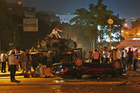 Tanks move into position as Turkish people attempt to stop them in Ankara, Turkey. Photo / AP