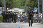 A police officer walks outside the Olympia mall in Munich, southern Germany. Photo / AP