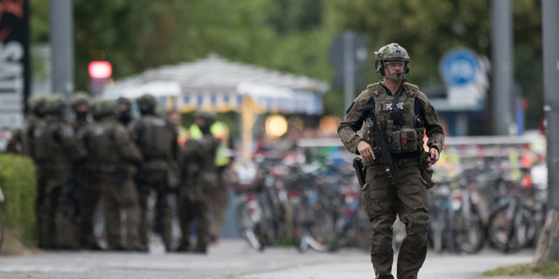 Loading A police officer walks outside the Olympia mall in Munich, southern Germany, Friday, July 22, 2016 after shots were fired. Police said that at least six people have been killed. (AP Photo/Sebastian Wi