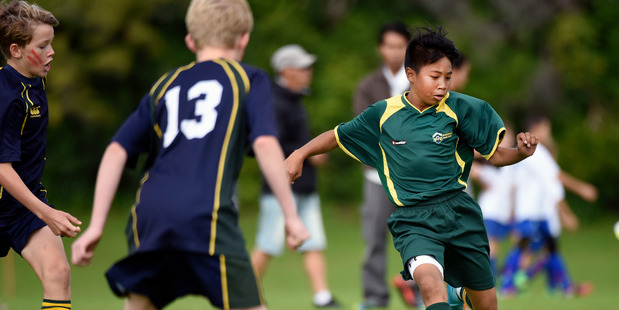 FOOTBALL FUN: WaiBOP and Mount Maunganui player Vincent Phirun on the ball. PHOTO/ FILE A_010516gn12bop