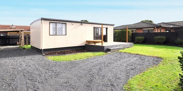 "The 50sq m house is described as ""cosy"" and sits at the rear of a cross-lease section. Photo / via Trade Me"