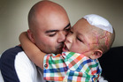 Orlando Shepherd with his son Shepherd Mea who was attacked by their dog in South Auckland on August 2, 2014. Photo / by Doug Sherring