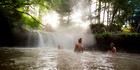 At Kerosene Creek in the Bay of Plenty, bathers can have their backs massaged by waterfall. Photo / Destination Rotorua