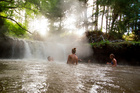 At Kerosene Creek in the Bay of Plenty, bathers can have their backs massaged by waterfall. Photo / Destination Rotorua