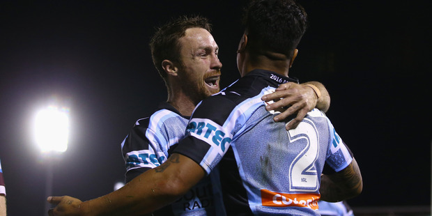 James Maloney, left, and Sosaia Feki of the Sharks are expected to qualify top ahead of the playoffs. Photo / Getty Images