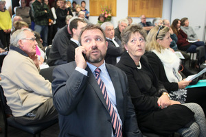 Rob Nankervis of Collier's International speaks to his eventual buyer during the packed auction at Collier's International.