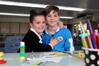 Alice, 6, and Thomas Monteith, 11, from Hastings, enjoy the school holiday programme at the Hastings Library. Photo / Paul Taylor