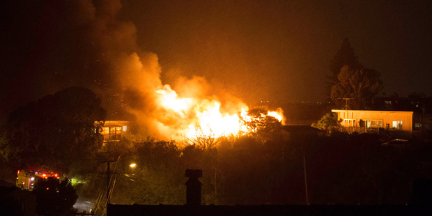 Too close for comfort: The photos show how close neighbouring properties are to the fire in Castor Bay Photo / Jo Ottey