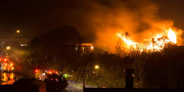 Four fire trucks were attending the fire at Castor Bay. Photo / Jo Ottey