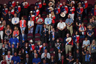 Convention goers from Texas remove their hats during the invocation at the start of the Republican National Convention on Monday in Cleveland. Photo / Washington Post