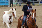 Multi-tasker Craig Wiggins writes a shopping list whilst training horses and commentating a rodeo.