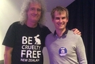 Nick Braae (right) with Queen guitarist Brian May.