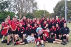 John Paul College under-18 development team celebrate after recently finishing second in an Australian rugby tournament on the Gold Coast.