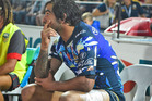 Johnathan Thurston of the Cowboys sits on the bench with ice strapped to his leg. Photo / Getty