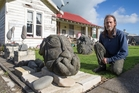 Gary Couper at home in Manaia, Taranaki, with his rocks carved from local stone. Pictures / Mark Mitchell