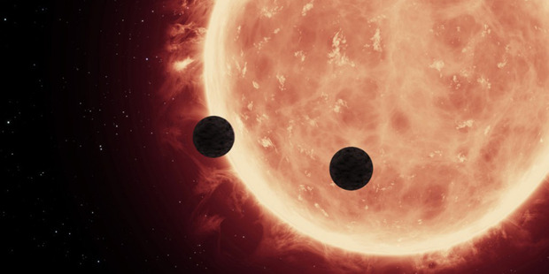Artist's view of planets transiting a red dwarf star in the TRAPPIST-1 system. Photo / NASA, European Space Agency and Space Telescope Science Institute