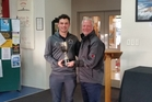 SPOILS OF VICTORY: Northland captain Lee Neumann accepting the trophy for their senior men's victory with Golf Northland President Rob Pelsky.