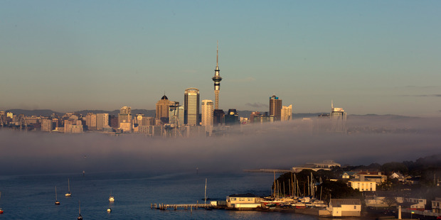 Early morning fog, Sky Tower and Auckland CBD skyline, on Thursday morning. 08 August 2013 New Zealand Herald photograph by Brett Phibbs