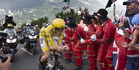 Fans cheers as Britain's Chris Froome, wearing the overall leader's yellow jersey, passes during the eighteenth stage of the Tour de France. Photo / AP