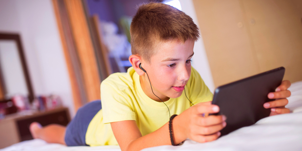 Research shows that screen-time distorts and damages our children's brains. Photo / iStock