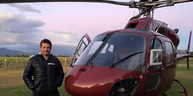 Richie McCaw poses with a helicopter. Photo / RichieMcCaw07 - Facebook