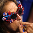 A delegate whistles as roll call votes are cast during the second day of the Republican National Convention in Cleveland, Tuesday, July 19, 2016. Photo/AP