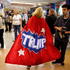 Minnesota delegate Mary Susan walks around the hallway in her Trump cape at Quicken Loans Arena before the start of the second day session of the Republican National Convention in Cleveland. Photo/AP
