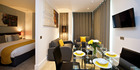 The apartment's decor was simple and contemporary, with a bee motif running throughout. Photo / Supplied
