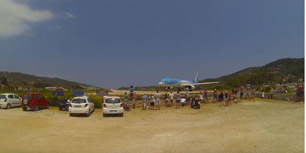Loading Tourists crowd around the runway prior to take-off. Photo / YouTube, Cargospotter