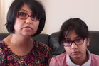 Ira Saxena, 9, and her mother, Priya, are desperate for a cure for the painful condition. Priya says the longest Ira has gone during the day without sneezing is about 25 minutes. Photo / YouTube