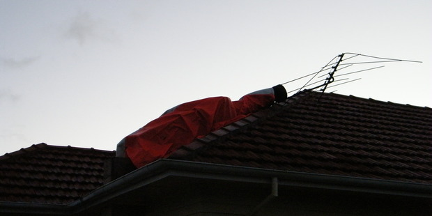 The Te Awamutu family's chimney was destroyed, breaking tiles on the roof. Photo / Supplied