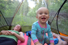 Talon in a tent in the Rattlesnake Wilderness, Montana - camping gear creates hours of entertainment for babies. Photo / Rob Roberts