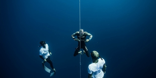 DEFIANT: William Trubridge (centre) will attempt another world freediving record tomorrow. PHOTO ALEX ST.JEAN