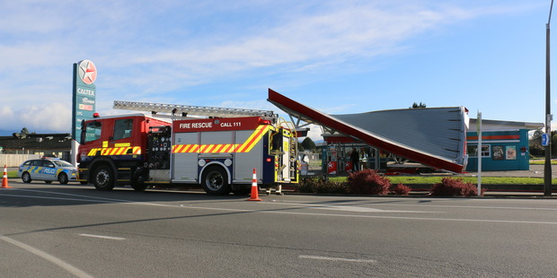 The roof of the Solway Caltex petrol station, Masterton, collapsed after a pillar holding it up was hit by a vehicle traveling at high speed. Photo / Supplied