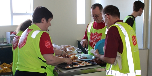 Lynda Ellington (left), the Dannevirke Salvation Army mission director, with Alan Murray from Wellington and Barry Ellington prepare food for Saturday's lunch during Exercise Viking Thunder.